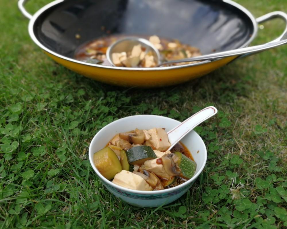 Zucchini Mushroom Tofu in wok on the meadow